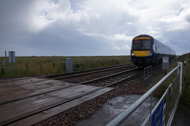 Train passing level crossing south of Arbroath