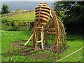 SK5374 : Wooden mammoth at Creswell Crags by Richard Green
