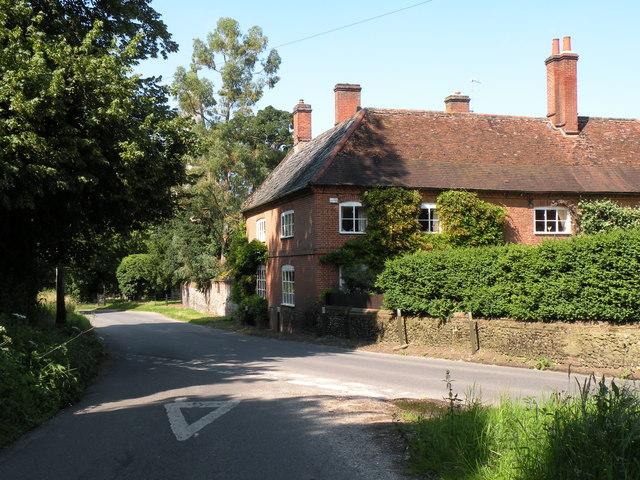 Old house by St. Andrew's church in Quidenham village