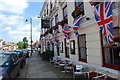 SU8821 : Union Flags hanging from The Angel Hotel by Barry Shimmon