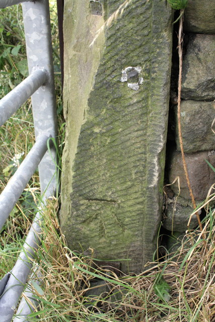 Benchmark on gatepost on Sty Lane