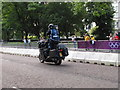 TQ2779 : Olympics triathlon Hyde Park - TV motorbike by David Hawgood