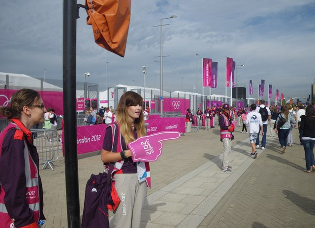 Directing spectators at the Olympic Village entrance