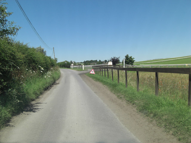 Maddle Road passes entrance to Mandown Gallops