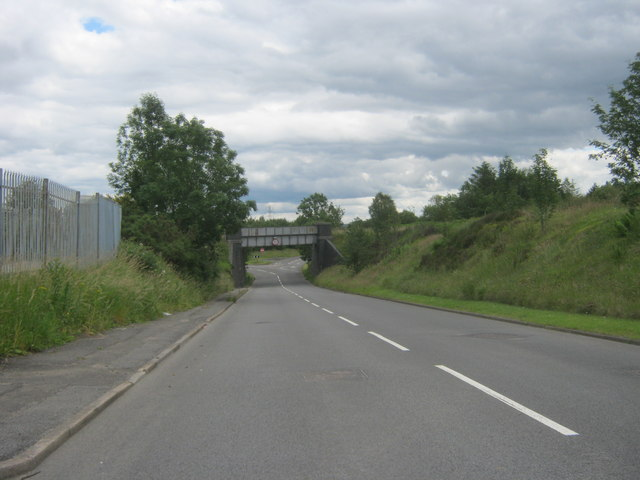 The A4109 heading to pass under a railway bridge at Dyffryn Cellwen
