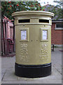 SJ3350 : Gold painted post box in Town Hill, Wrexham by John S Turner