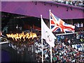 TQ3783 : The Olympic Torch and flags by Graham Hogg