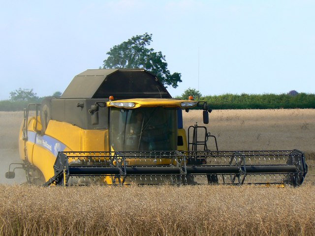 Foreshortened view of a New Holland combine harvester, Driffield Cross Roads, Gloucestershire
