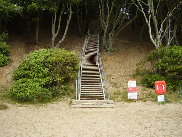 Steps off the beach to High Cliff Castle