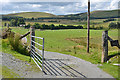 SN9576 : Gate on the road by Nigel Brown