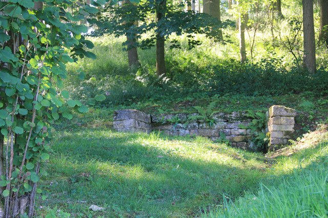 Remains of a small building in Chedworth Woods
