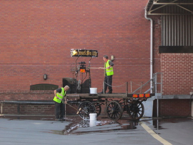 Cleaning the horse drawn dray