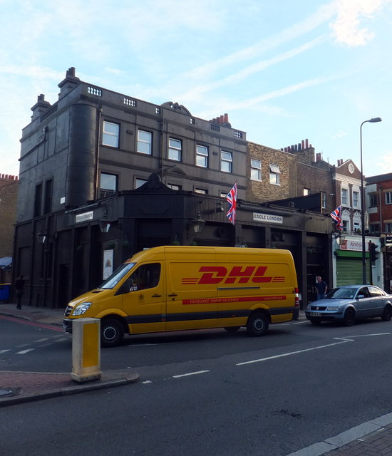 DHL Van passing Eagle London in Kennington Lane