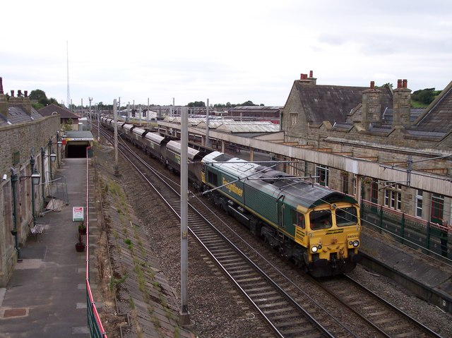 Freightliner diesel train heads north out of Carnforth