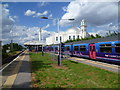 TQ2567 : Morden South station and the Ahmadiyya Mosque by Ian Yarham