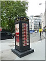 TQ2881 : Phone box in Hanover Square by Basher Eyre