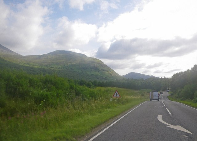 Undulating grassland and woodland along the A82