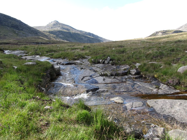 The rocky bed of the stream flowing from Binnian Lough