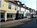 SO7225 : Broad Street charity shop and butcher's shop, Newent by John Grayson