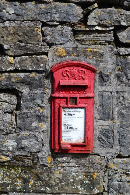 Old post box set in a limestone wall in Grindlow