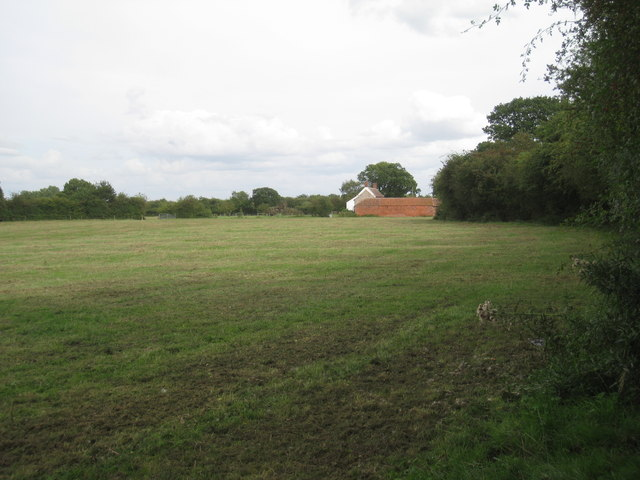 Grass field and Westfield House