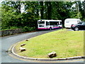 SN9107 : First bus waits in the Min-yr-awel turning circle,  Pontneddfechan by John Grayson