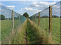 Dist:0.4km<br/>The footpath from the end of Grange Road towards Rowtown. Walkers can be confident of protection from marauding herds of sheep by dint of the erection of 6 foot high chain link fences along the full length of the footpaths in this area.