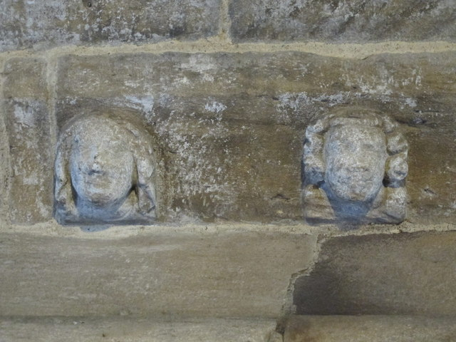 Aydon Castle - carved heads above fireplace