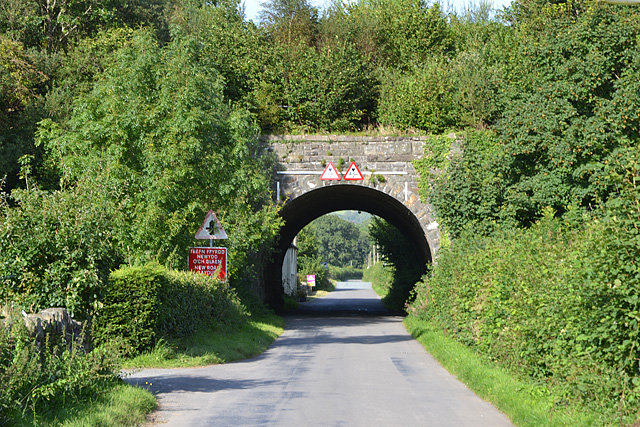 Road approaching railway bridge in Llanbrynmair