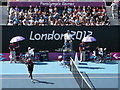 TQ3785 : Sitting under purple umbrellas, Olympic Park by David Anstiss