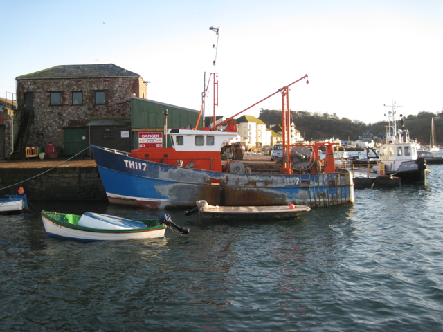 Damaged fishing boat at the New Quay