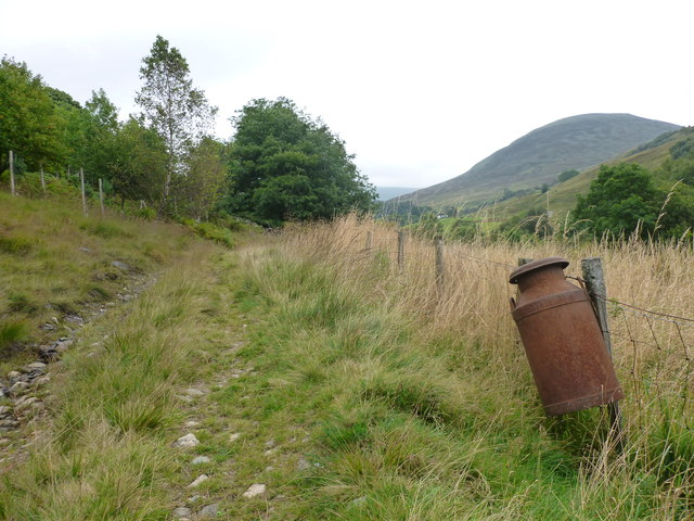 Old metal milk can on a fence, Milton of Ardtalnaig