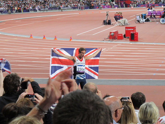 Paralympics GB athlete Paul Blake on a lap of honour