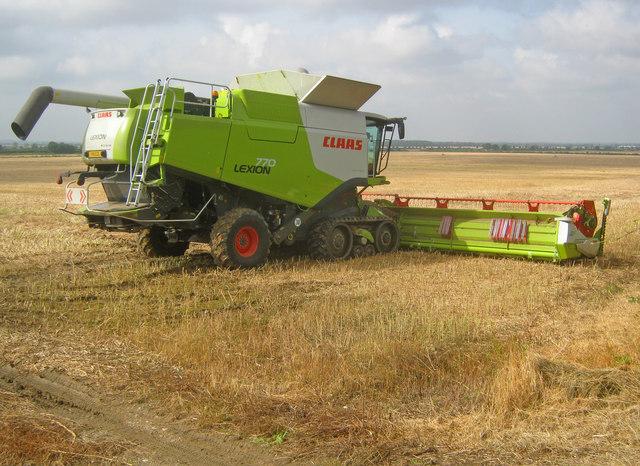 Resting combine harvester near Castle Lane