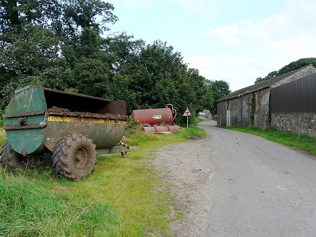 Agricultural equipment and an old barn
