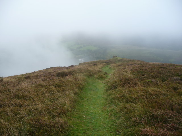 View down the Darren Lwyd to the monastery at Capel-y-ffin through hill fog