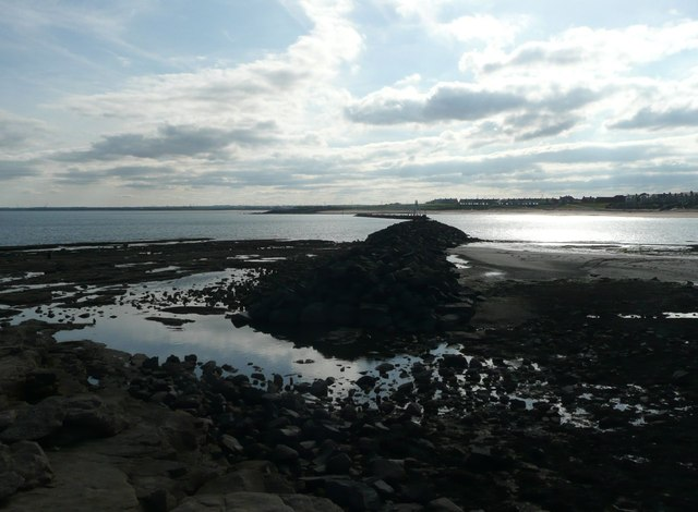 The old breakwater in Newbiggin Bay