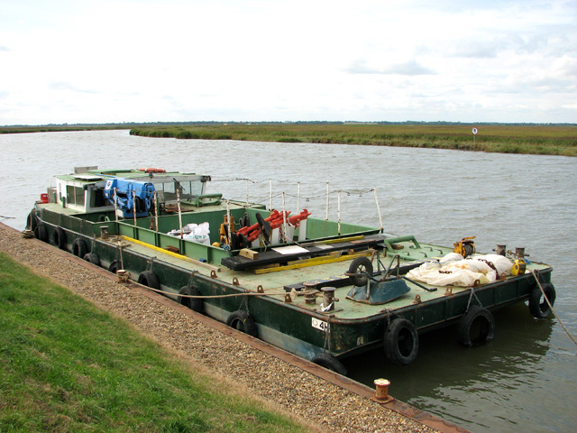 Broads Authority barge moored on the River Waveney