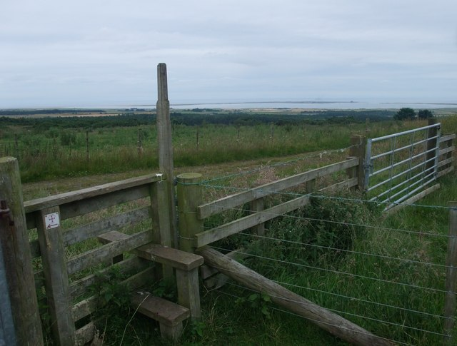 Stile on St Cuthbert's Way, and view of the Way's end