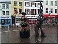 H4572 : Balance in the wet, Market Street, Omagh by Kenneth  Allen
