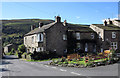 SD9598 : Houses in Gunnerside by Trevor Littlewood