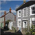 TG0244 : Brick and flint cottages, Blakeney by Pauline E