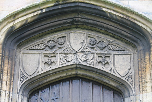 Carvings above West Door, St Andrew's church, Folkingham
