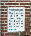 SJ9596 : Opening Hours at Newton Library by Gerald England