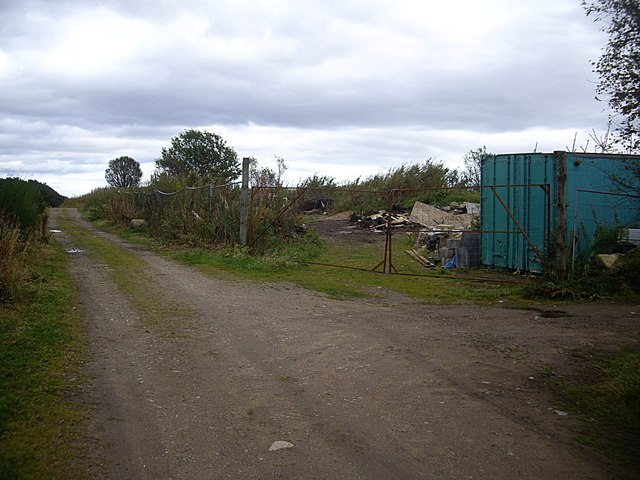 Gated entrance to a waste dump