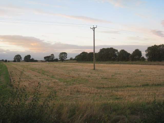 Pole in the middle of a field