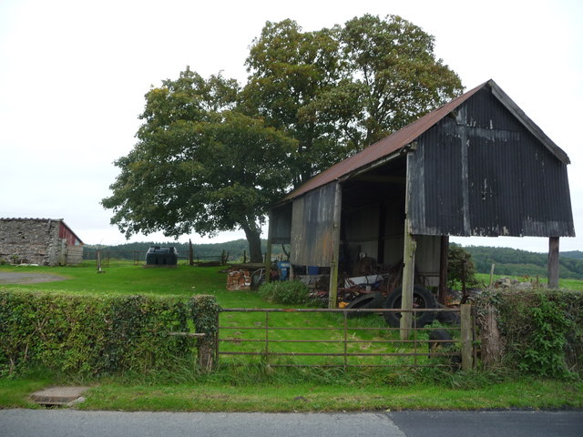 Old corrugated barn beside the road
