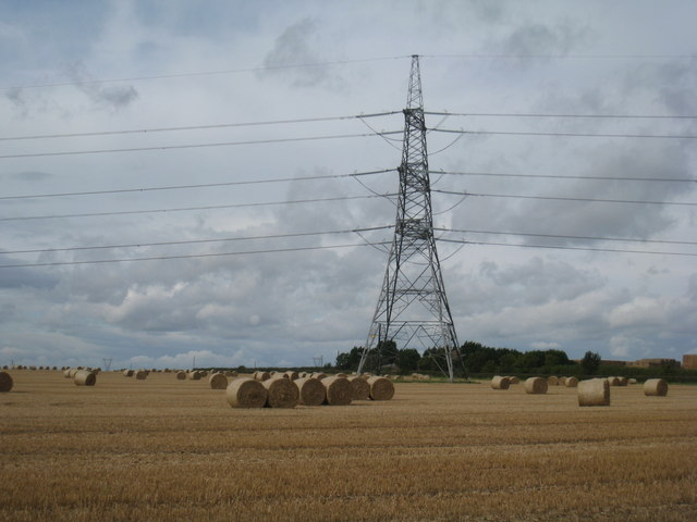 Electricity pylon and straw bales