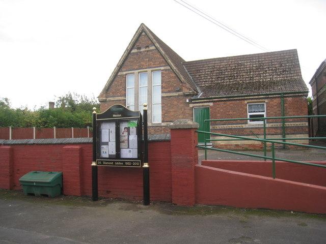 Village noticeboard and Village Hall, Weston