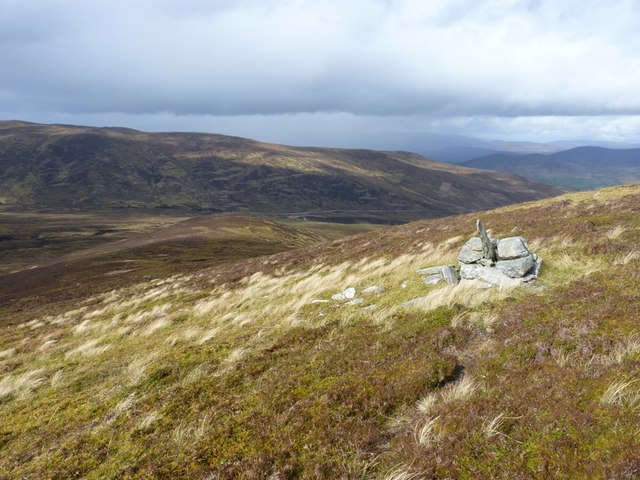 Unmarked cairn on the hillside